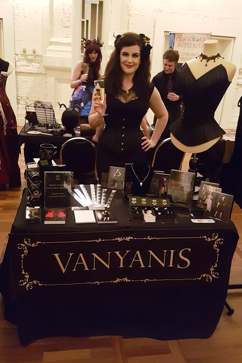 Lowana at the Vanyanís stand. She's wearing the Ebonique Pencil Dress styled with a bespoke corset © Vanyanís