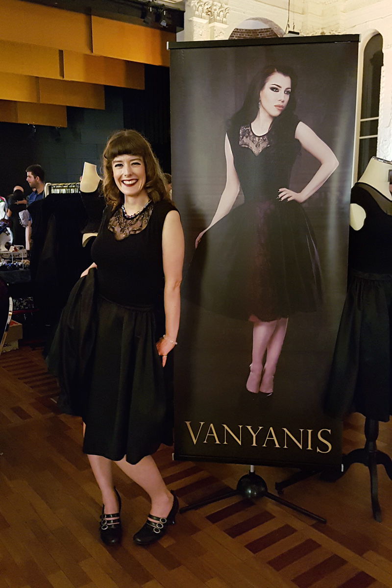 Our assistant Erika standing next to a banner of Morgana © Vanyanís