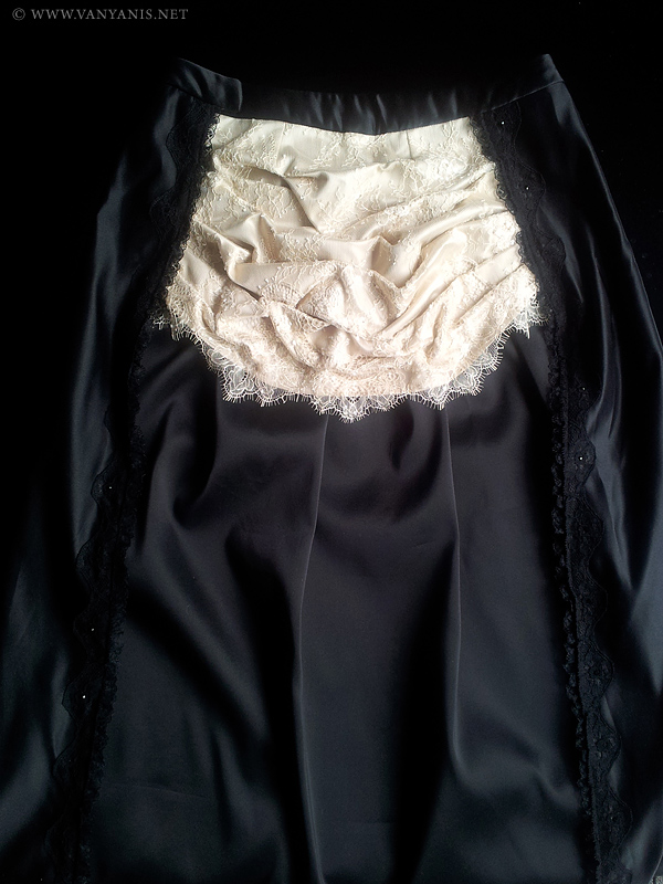Front view of the skirt showing the cream silk and lace