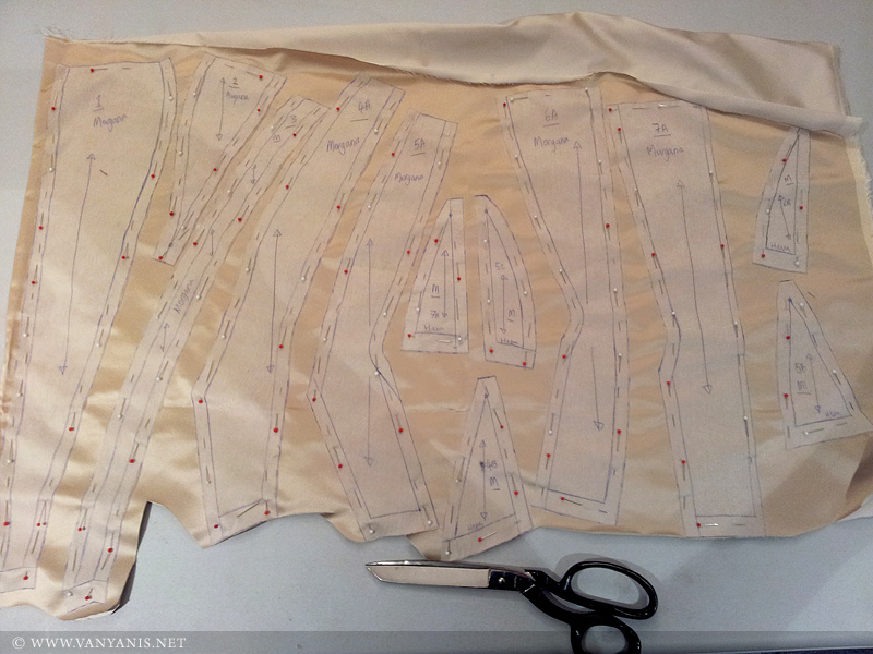 The corset pattern pinned to the silk ready to cut out