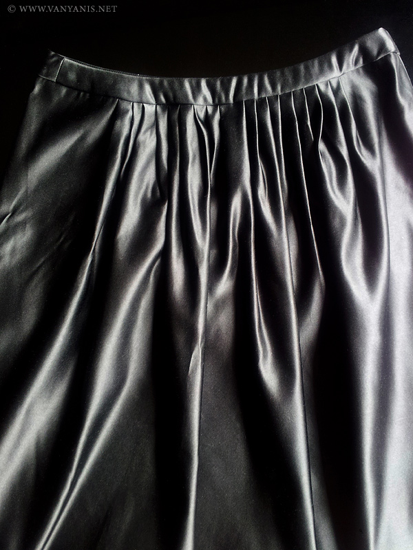 Back view of the silk skirt showing the pleats and waistband