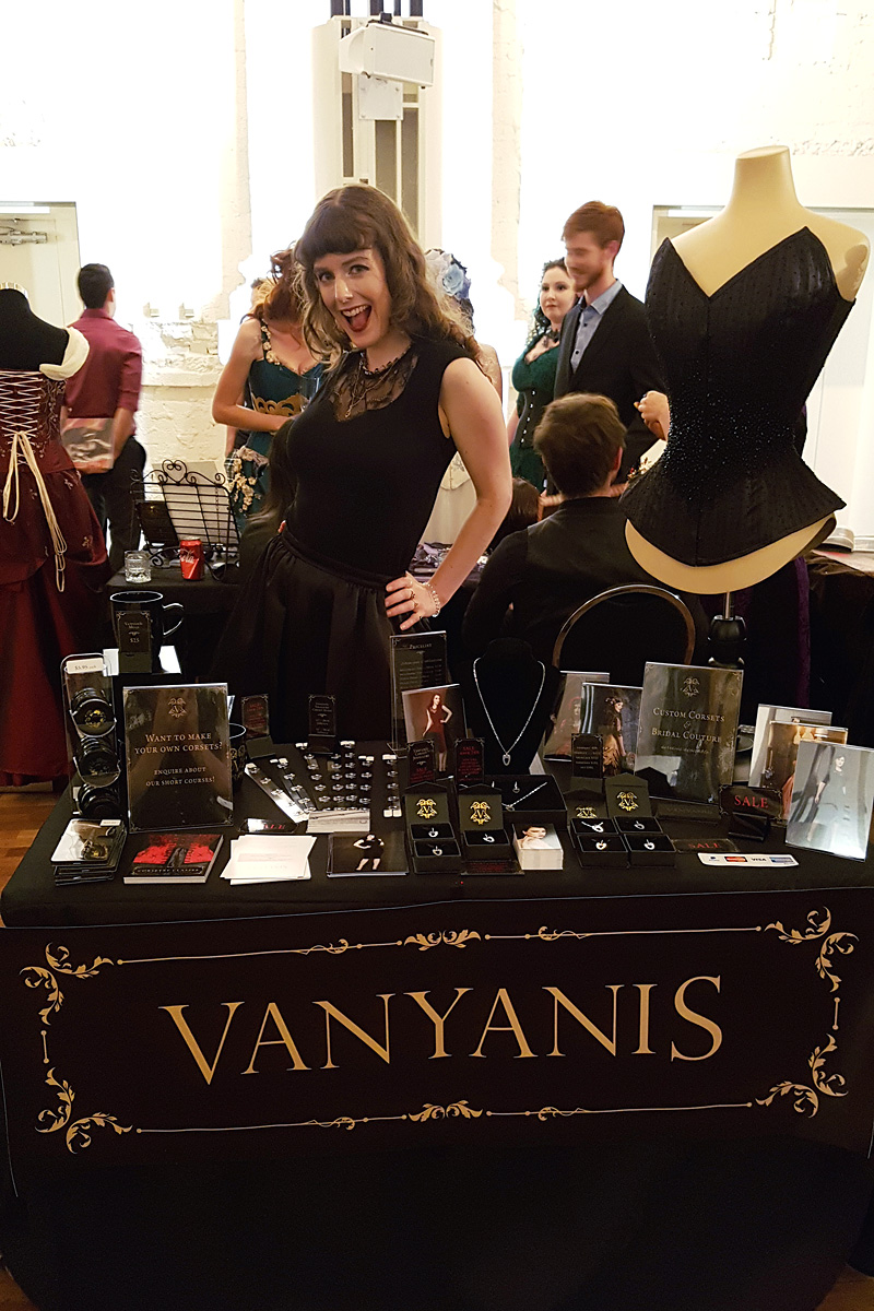 Lovely Erika at the Vanyanís stand. She's wearing the Ebonique Sweetheart Top and the Ebonique Skirt © Vanyanís